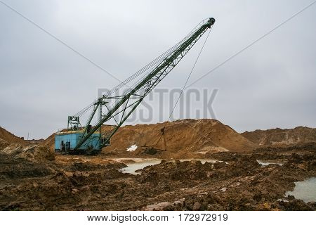 Walking excavator type dragline ЭШ 10/70 in a clay quarry near the town of Pology of Zaporizhzhya region of Ukraine. Following heavy rains. March 2006