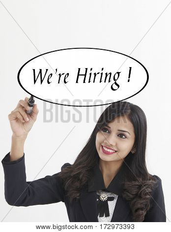 businesswoman holding a marker pen writing -now hiring