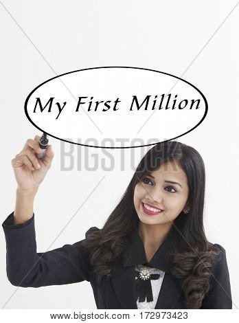 businesswoman holding a marker pen writing - my first million