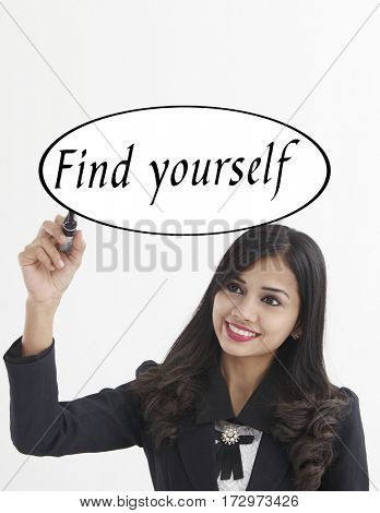 businesswoman holding a marker pen writing -find yourself