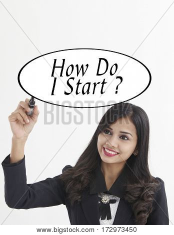 businesswoman holding a marker pen writing -how do i start