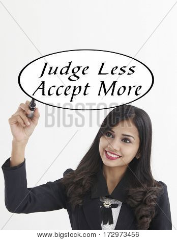 businesswoman holding a marker pen writing -judge less accept more