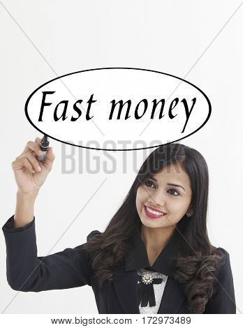 businesswoman holding a marker pen writing -fast money