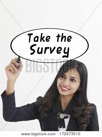 businesswoman holding a marker pen writing -take the survey
