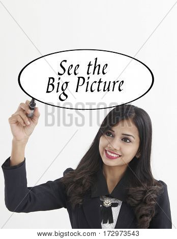 businesswoman holding a marker pen writing -see the big picture