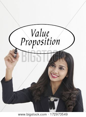 businesswoman holding a marker pen writing -value proposition