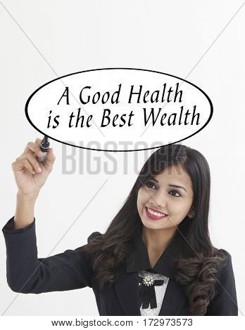 businesswoman holding a marker pen writing -a good health is the best wealth