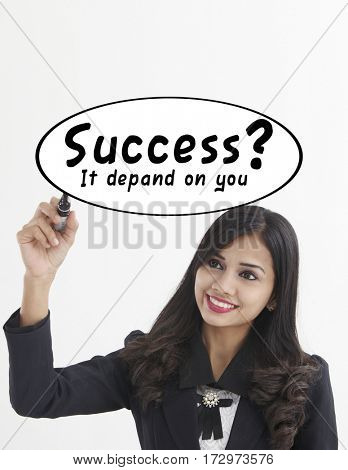 businesswoman holding a marker pen writing -success it depand on you
