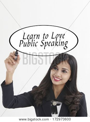businesswoman holding a marker pen writing -learn to love public speaking