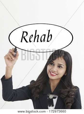 businesswoman holding a marker pen writing -rehab