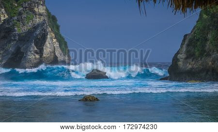 Huge Wave hitting the Rock in the ocean at Atuh beach on Nusa Penida island, Indonesia.