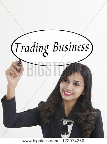 businesswoman holding a marker pen writing -trading business
