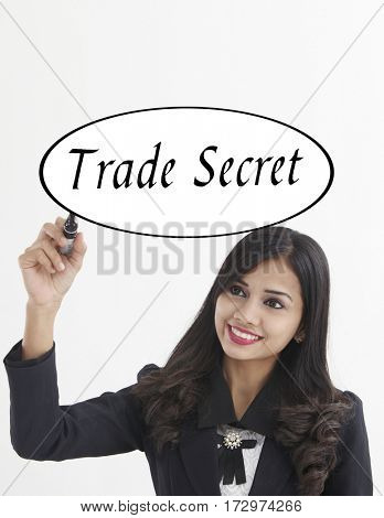 businesswoman holding a marker pen writing -trade secret