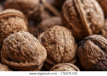 Background of group close walnuts. Close-up or macro photo.