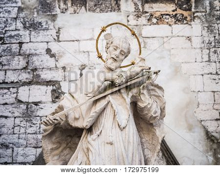 LISBON PORTUGAL - JANUARY 19 2017: Statue of John of Nepomuk in the Convent of Our Lady of Mount Carmel in Lisbon Portugal.