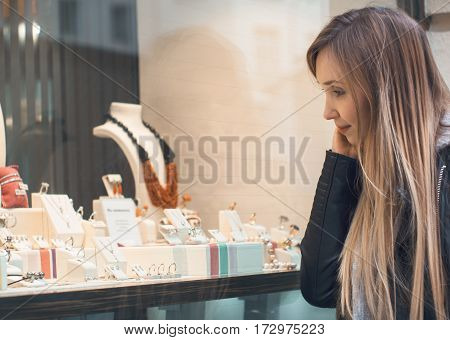 Young Girl Looking Jewelry