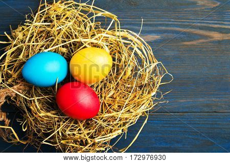Easter Eggs On A Wooden Background .easter Eggs Of Different Colors .easter Eggs Top View