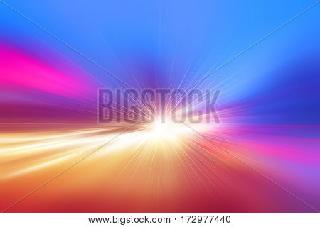Abstract image of traffic lights with motion blur on the road.