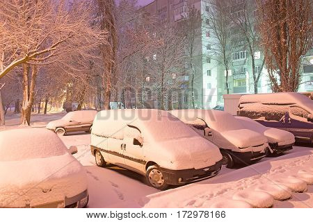 lights of car on parking in dark foggy winter evening
