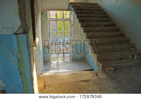 stairs inside abandoned building in the evening