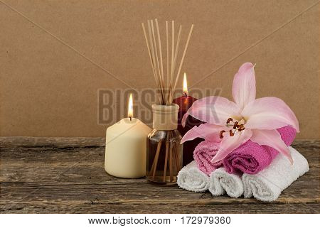 Beautiful composition with burning candles and aromatic oil on wooden background, spa and wellness concept