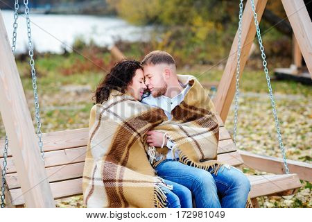 Amorous Couple On Romantic Date On Swings Outdoor