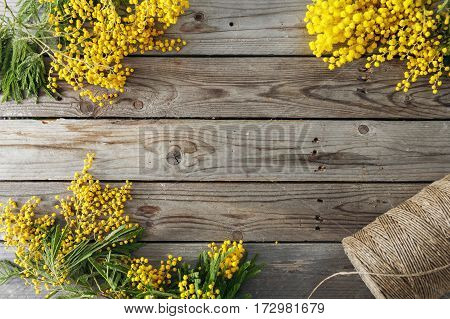 Mimosa flowers on gray wooden background. old wooden table. Copy space for text