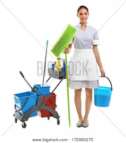 Hotel female chambermaid with cleaning supplies on white background