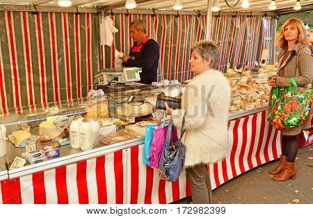 Verneuil sur Seine; France - october 16 2016 : dairy produce at the market in automn