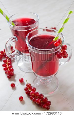 Two cup of red currant aerated lemonade with green straw
