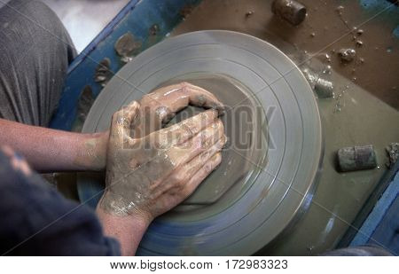 clode up of a potters hands making a bowle