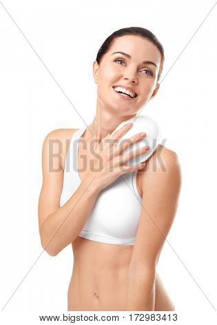 Beautiful young woman using wisp on white background