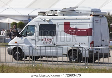 BERLIN / GERMANY - JUNE 3 2016: Broadcast tv car from rbb ( rundfunk berlin brandenburg) drives on airport berlin.