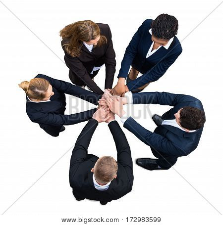High Angle View Of A Businesspeople Stacking Hands Together On White Background