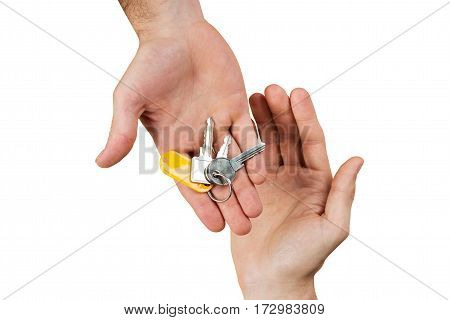 Close-up Of A Person Hand Giving Home Keys To A Client On White Background