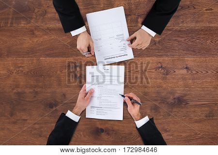 High Angle View Of A Businessman Conducting An Employment Interview