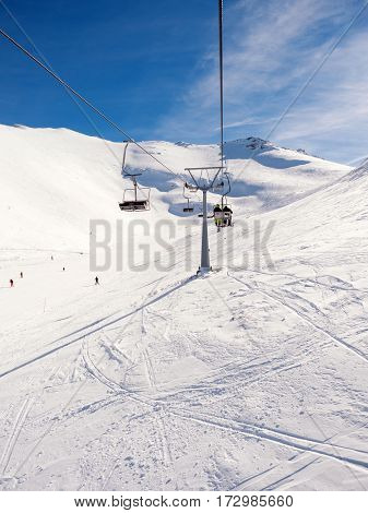 Kalavrita Greece - January 28 2017:View from the lift of Kalavrita ski resort with people on the slopes in a sunny day