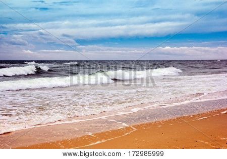 coastline with yellow sand, sea and blue sky