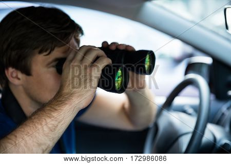 Private Detective Looking Through Binoculars Sitting Inside Car