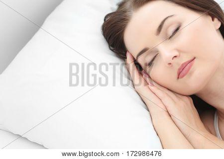 Closeup of young attractive woman sleeping in bedroom