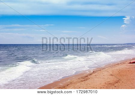 coastline with yellow sand, blue sea and sky