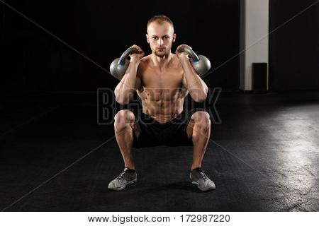 Portrait Of A Young Fitness Man Working Out With Kettle Bell In The Gym