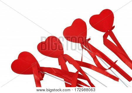 Four decorative hearts with ribbon on white background isolated