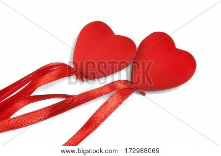 Two decorative hearts with ribbon on white background isolated