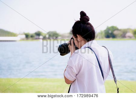 Beautiful Women Professional Photographer Takes Images With Dslr Camera., In The Park.