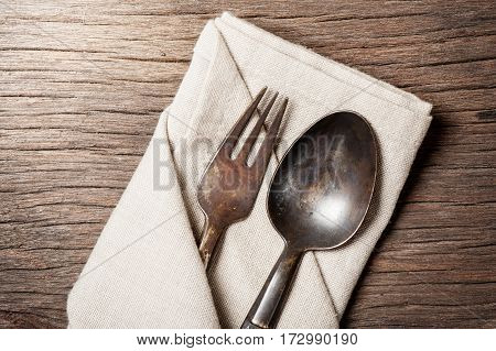 Spoon And Fork On Wooden Table