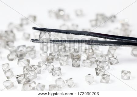 Natural  transparent diamond in tweezers in macro
