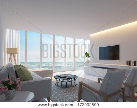 Modern white living room with sea view 3d rendering image. Decorated room with warm light white furniture. There are large windows Looking to beautiful sea view