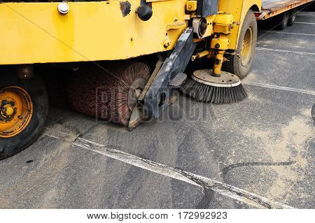 close up on road sweeper in parking lot