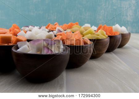 Turnips and Root Vegetables Diagonal on wooden table top